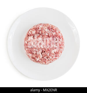 Raw red meat burger for hamburgers of minced ground beef or pork in plate ready for cooking. Isolated on white background. Top view. - Stock Photo