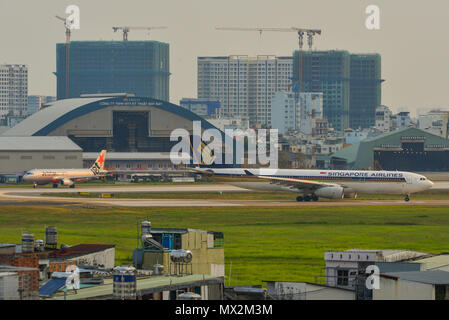 Saigon, Vietnam - Mar 11, 2018. Passenger airplanes at Tan Son Nhat Airport (SGN) in Saigon (Ho Chi Minh City), Vietnam. - Stock Photo