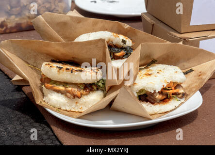 food samples, variations of diverse Asian burgers. The meat burgers served in the rice buns during the Asian street farmers market. - Stock Photo