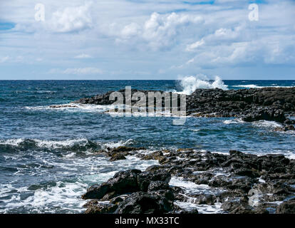 Waves breaking on rocky shore, Easter Island, Rapa Nui, Chile - Stock Photo