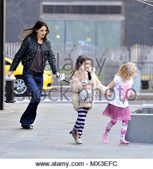 Katie Holmes and Suri Cruise. Suri Cruise seems to have made a new BFF. The little fashionista was seen holding her new  blonde BFF's hand while being picked up by mother Katie Holmes from her friends apartment building. The trio were seen running to their waiting car in efforts of dodging the paparazzi's cameras. - Stock Photo