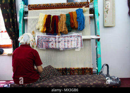 At Goreme - Turkey - On  August/05/2010  woman making wool carpet at a loom in Turkey - Stock Photo