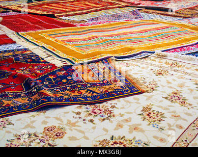 handmade traditional carpets in a textile manifacturing in Turkey - Stock Photo