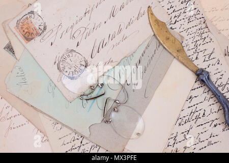 background with old vintage letters and vintage letter opener - Stock Photo