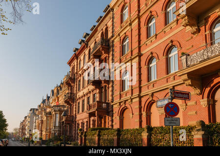 Sun shines on beautiful old houses at Uferstrasse in Mainz early in the morning - Stock Photo