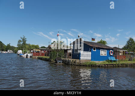allotment gardens at the old trave, lubeck, germany - Stock Photo