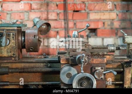 Turning lathe in the workshop. - Stock Photo