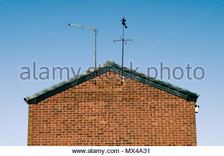 A witch weather vane on top of a house on a sunny day in Bradford, West Yorkshire, England, Great Britain - Stock Photo