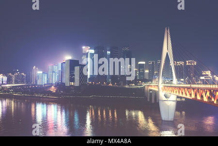 Chongqing City skyline at night, color toned picture, China. - Stock Photo