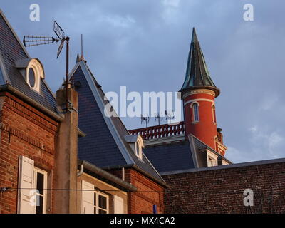Turret of Les Tourelles restaurant and hotel against the cloudy sky of Northern France, Le Crotoy, France - Stock Photo