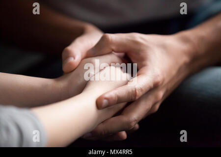 Male hands holding female, giving psychological support concept, - Stock Photo