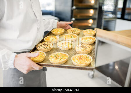 Holding tray with freshly baked buns - Stock Photo