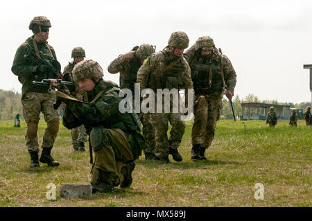 Soldiers from the 1st Airmobile Battalion, 79th Air Assault Brigade practice evacuating a casualty under fire during combat life-saver training at the Yavoriv CTC on the International Peacekeeping and Security Center near Yavoriv, Ukraine on May 3, 2017.    CTC trainers, partnered with Soldiers of the U.S. Army's 45th Infantry Brigade Combat Team, are building professionalism within the Ukrainian military through structured training. The 45th IBCT is deployed as part of the Joint Multinational Training Group-Ukraine and is paired with Canadian, U.K., Polish, Lithuanian, and Danish service memb - Stock Photo