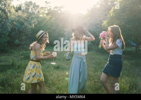Group of girls friends making picnic outdoor. They have fun - Stock Photo