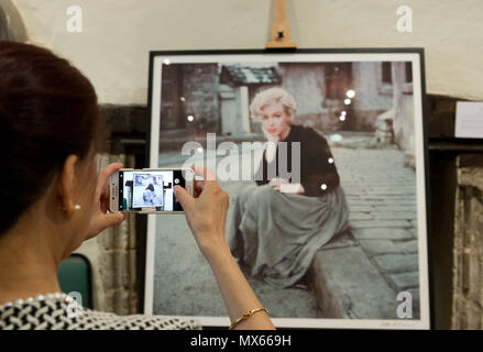 Bury St Edmunds, UK. 2nd Jun, 2018. Guest takes a photo of one of the exhibits at the 'Timeless' exhibition at Moyses Hall, Bury St Edmunds, which includes stunning images from Marilyn Monroe's very earliest days as a model, behind-the-scenes captures from her film-work, breathtaking location and studio work and emotive candid images that showcase her true personality in a unique and engaging way. Credit: Keith mindham/Alamy Live News - Stock Photo