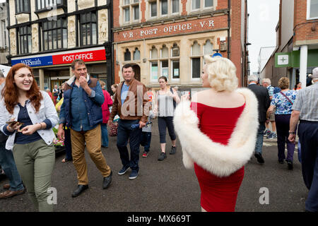 Bury St Edmunds, UK. 2nd Jun, 2018. Suzie Kennedy the world's leading Marilyn Monroe tribute artist, making her way through the market on her way to open the 'Timeless' exhibition at Moyses Hall, Bury St Edmunds, UK which includes stunning images from Marilyn Monroe's very earliest days as a model; behind-the-scenes captures from her film-work; breathtaking location and studio work and emotive candid images that showcase her true personality in a unique and engaging way. Credit: Keith mindham/Alamy Live News - Stock Photo
