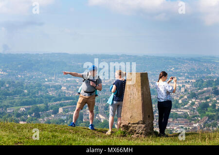 Batheaston, Somerset, UK weather. 3rd June 2018. People walking up and on top of Little Solsbury Hill, which overlooks the city of Bath, on a warm, sunny, summer morning in the west of England. Credit: Richard Wayman/Alamy Live News - Stock Photo