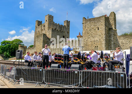 Rochester, Kent, UK. 03rd June, 2018. BAE brass band plays in front of Rochester castle at the anual Rochester Dickens festival Credit: lifes all white/Alamy Live News - Stock Photo