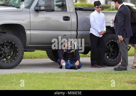 FORT LAUDERDALE,  FL - FEBRUARY 20: Peter Wang, 15, who was among the 17 people killed by a gunman at Marjory Stoneman Douglas High School in Parkland, Florida was admitted to the class of 2025 at his dream school, West Point Academy.  There was a memorial service for him at Kraeer Funeral Home and Cremation Center and than he was laid to rest at Bailey Memorial Gardens on February 20, 2018    People:  Peter Wang - Stock Photo