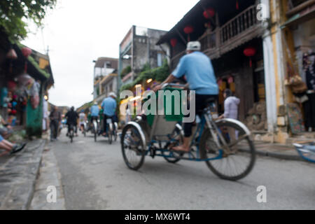 The cyclos in Hoi An old town. Stock photo of cyclo on street, cyclo is the favorite transportation in Hoi An - Stock Photo