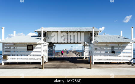 Entrance facade of the Woody Point Jetty, a 240 meters long pier in the Redcliffe Peninsula, Queensland, Australia - Stock Photo