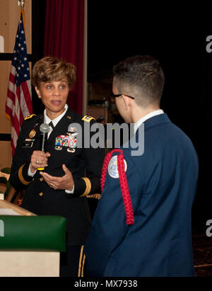 .S. Army Lt. Gen. Nadja West, U.S. Army surgeon general and commander, U.S. Army Medical Command, answers a question from Brentwood High School sophomore and Air Force Junior ROTC Cadet Ahmad Perez at a school event in Brentwood Hamlet, Islip, New York, May 2, 2017. West was invited to speak at the school after Perez sent her an email looking to learn more about a career in medicine. - Stock Photo