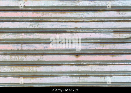 metal fence made of corrugated steel sheet with vertical guides - Stock Photo