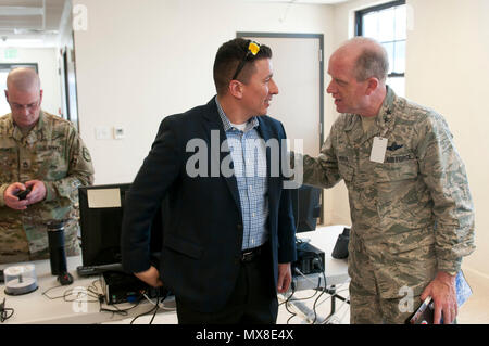 Maj. Gen. Don Dunbar, the adjutant general of the Wisconsin National Guard, meets a civilian mission partner attending Cyber Shield 17 at Camp Williams, Utah, May 3, 2017.  Cyber Shield is a National Guard exercise designed to assess Soldiers, Airmen and civilian personnel on response plans to cyber incidents taking place April 24 to May 5, 2017 at Camp Williams, Utah. (Wisconsin Army National Guard : Staff Sgt. Matthew Ard) - Stock Photo