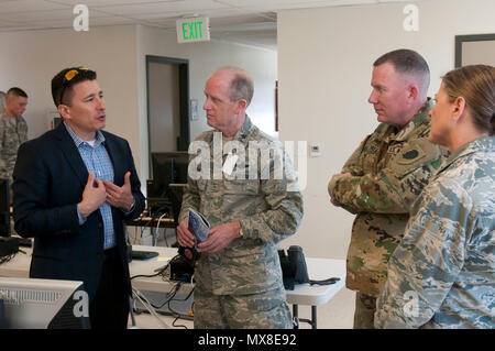 Maj. Gen. Don Dunbar, the adjutant general of the Wisconsin National Guard, and Maj. Gen. Richard Hayes, the adjutant general of the Illinois National Guard meet with civilian mission partners during Cyber Shield 17 at Camp Williams, Utah, May 3, 2017.  Cyber Shield is a National Guard exercise designed to assess Soldiers, airmen and civilian personnel on response plans to cyber incidents taking place April 24 to May 5, 2017. (Wisconsin Army National Guard : Staff Sgt. Matthew Ard) - Stock Photo