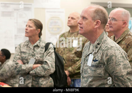 Maj. Gen. Don Dunbar, adjutant general of the Wisconsin National Guard, recieves a briefing from cyber analysts, while visiting the Cyber Shield 17 exercise at Camp Williams, Utah, May 3, 2017. Cyber Shield is a National Guard exercise designed to assess Soldiers, Airmen and civilian personnel on response plans to cyber incidents taking place April 24 to May 5, 2017 at Camp Williams, Utah. (Wisconsin Army National Guard : Staff Sgt. Matthew Ard) - Stock Photo
