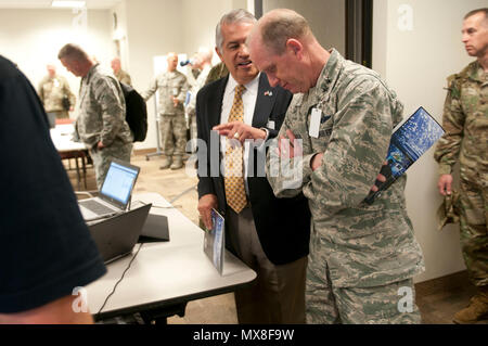 Maj. Gen. Don Dunbar, the adjutant general of the Wisconsin National Guard converses with David Cagigal, chief information officer for the State of Wisconsin, during the Cyber Shield 17 exercise at Camp Williams, Utah, May 3, 2017.  Cyber Shield is a National Guard exercise designed to assess Soldiers, Airmen and civilian personnel on response plans to cyber incidents taking place April 24 to May 5, 2017 at Camp Williams, Utah. (Wisconsin Army National Guard : Staff Sgt. Matthew Ard) - Stock Photo