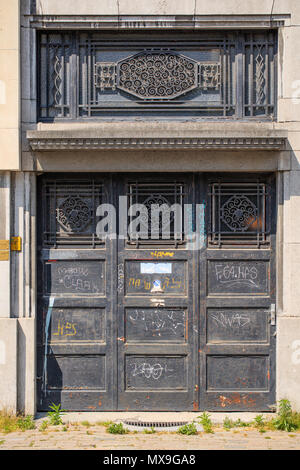 ANTWERP-MAY 21, 2018. Ornate metal door of an abandoned mansion. The old city center of Antwerp is steeped in history with many ancient mansions. - Stock Photo