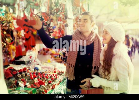 Happy married couple at Catalan Christmas market - Stock Photo