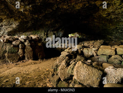 Ana Te Pahu lava tube cave, Easter Island, Rapa Nui, Chile, with manavai stone circles for growing produce used by ancient people as dwelling place - Stock Photo