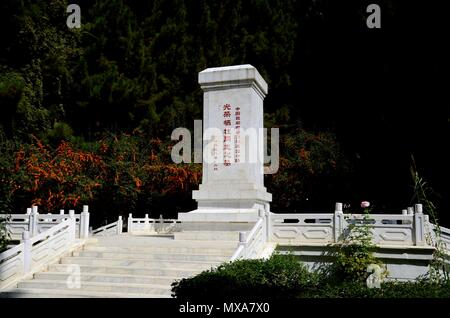 Remembrance monument for Chinese workers and soldiers working on Karakoram Highway with Chinese writing at China Cemetery Gilgit Pakistan - Stock Photo