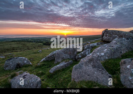 A beautiful Sunday morning June sunrise over the village of Belstone on Dartmoor - Stock Photo