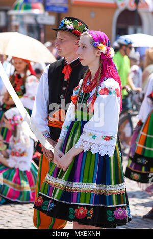 Lowicz / Poland - May 31.2018: View of a couple, man and woman dressed in a colorful folklore, regional costume during Corpus Christi Celebration. - Stock Photo