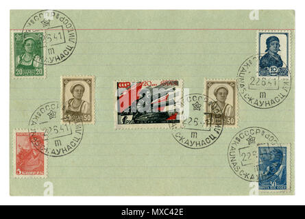 Soviet historical stamps: on a notebook sheet in a line with the cancellation of the first day of the war, June 22, 1941, Russia, Lithuania, USSR - Stock Photo