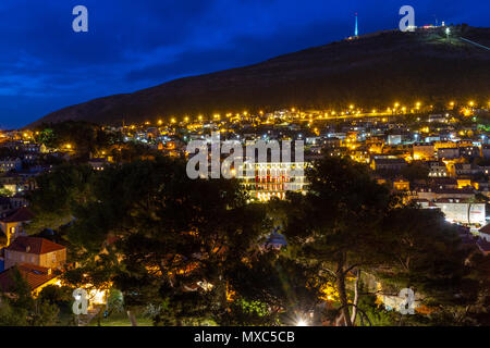 Night time view over rooftops in western part of Dubrovnik towards the Hilton Imperial and Mount Sud Dubrovnik, Croatia. - Stock Photo