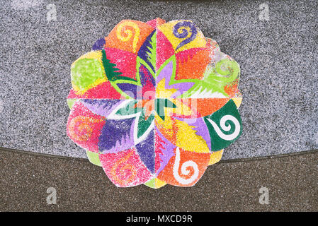 The rangoli or sand art or rice art with colorful decoration on the floor, one of the traditional part of indian wedding ceremony - Stock Photo