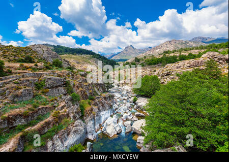 Stream and Mountain Range in Corsica, France in Springtime - Stock Photo