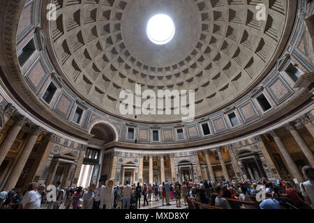 Rome Pantheon interior, light true the hole, tourists visiting - Stock Photo