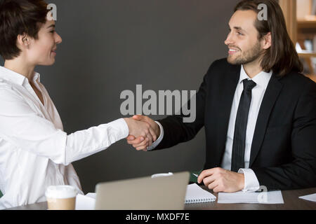 Business partners handshaking after closing successful deal - Stock Photo