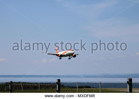 G-EZTG, an Easyjet A320 landing Bristol Airport, Bristol, UK - Stock Photo