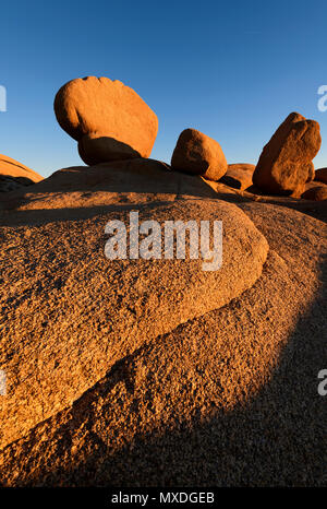 Sunrise on unique rock formations at Joshua Tree National Park in southern California, USA. - Stock Photo