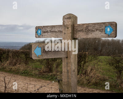 A sign points to the South Downs Way national trail in England's South Downs National Park on 10 February 2018. - Stock Photo