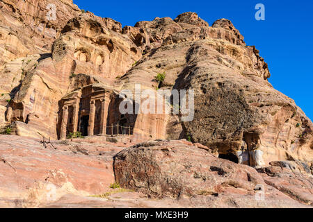 Old tombs at sunset in the Lost City of Petra, Jordan - Stock Photo