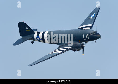 Douglas DC-3 Dakota, C-47 Skytrain. Second World War transport plane flying at an airshow. D-Day invasion stripes. Space for copy - Stock Photo