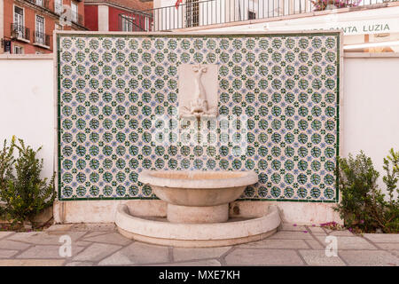 Fish fountain at Miradouro de Santa Luzia. Alfama, Lisbon, Portugal - Stock Photo