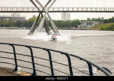 A man on a jet ski on the River Tees near the Infinity Bridge in Stockton on Tees,England,UK